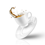 Fototapety Splash of tea in the falling cup isolated on white