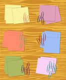 Collection of sticky notes in different colors with paperclips