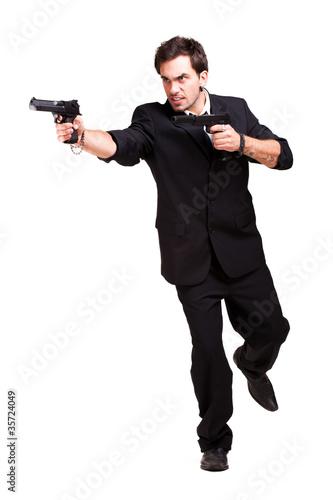 cooler Mann mit Pistolen