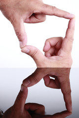 The space sorrounded by fingers is an arrow
