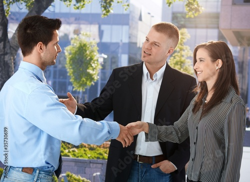 Businesspeople meeting outside of office