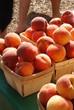 Stacks of fresh organic peaches at a Farmer's Market