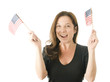 happy woman waving patriotic American flags