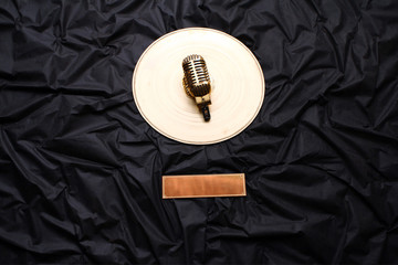 Golden microphone on the wall