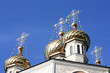 Golden dome of the Orthodox church with blue sky background, Rus