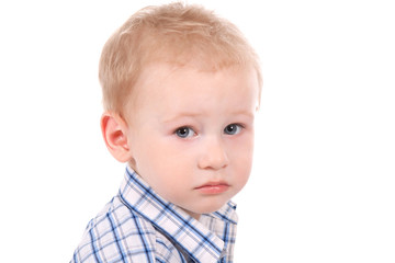 portrait of sad child over white background, close up