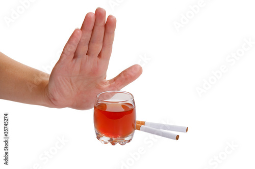 Hand rejects cigarette and alcohol. Stop smoking and drinking