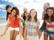 Teenage girls walking on beach