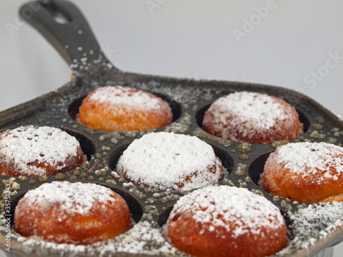 A Pan of Freshly Cooked Aebelskivers with Powdered Sugar