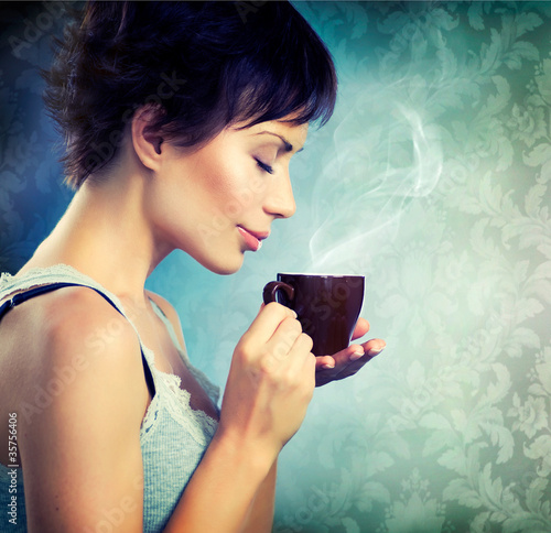 Beautiful Girl With Cup of Coffee