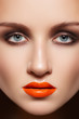 Glamourous woman face with fashion make-up. Sexy gloss makeup