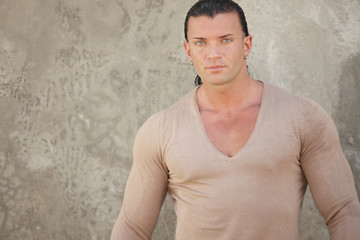 Image of a muscular man in a v-neck shirt