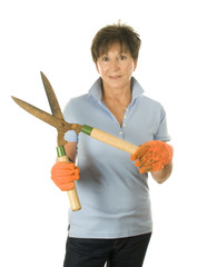 cute middle age woman garden hand tool hedge trimmer shears