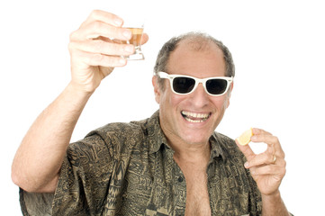 middle age senior tourist male sun glasses  drinking tequila sho