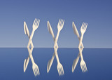 white plastic flatware on mirror