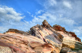 Fantastic geological formations on the rocky beach poster
