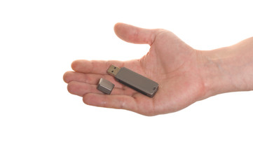well shaped hand with an USB flash isolated over white