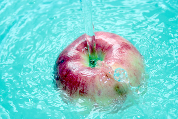 scene red apple in current water