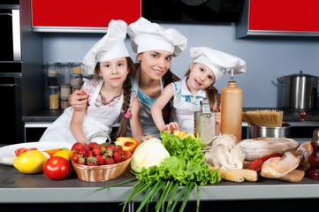 mother and two daughters in the kitchen