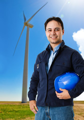 Worker in front of a wind power plant