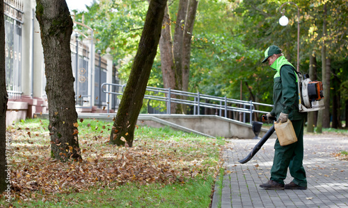 Landscaper operating gasoline Leaf Blower