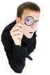 Funny man looking through a magnifying glass.