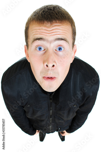 Funny man looks up on a white background.