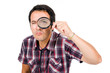 Funny image of a young man looking through magnifying glass, iso