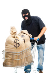 Happy robber with sacks full of dollars