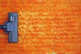 Fototapety vacuum cleaner on orange carpet