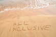 All inclusive text written on the beach sand