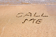 Call me text written on the beach sand