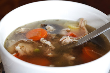Chicken soup with vegetables close-up