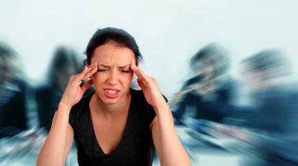 Woman heaving a headache during a staff meeting
