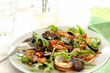 Warm rocket salad with bacon