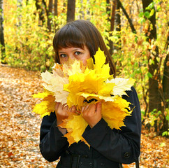 Girl in an autumn forest