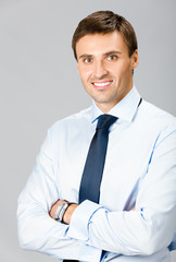 Portrait of business man, over gray background