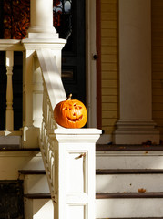 Halloween Pumpkin on White Guardrail