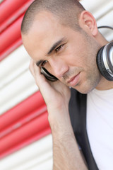 Young man with music headphones
