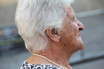 old lady with a hearing aid