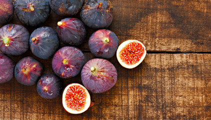 Ripe figs on a rustic wooden table