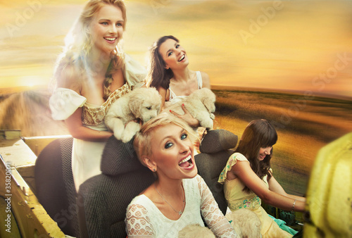 Smiling women driving a car