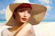 Beautiful woman in straw hat