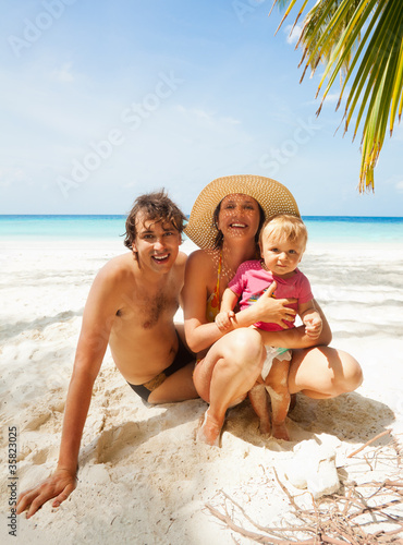 Family on Maldivian beach