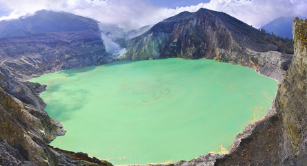 Sulphatic lake in a crater of volcano Ijen.  Indonesia