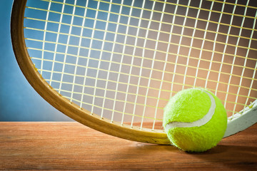 Sports equipment.tennis and racket on wood.