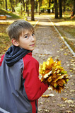 boy  in autumn park