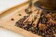 coffee grains and spices on wooden background