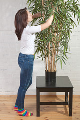 Young woman handles green bamboo