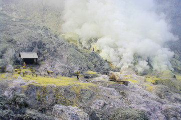 Workers are extracting sulphur inside Kawa Ijen crater